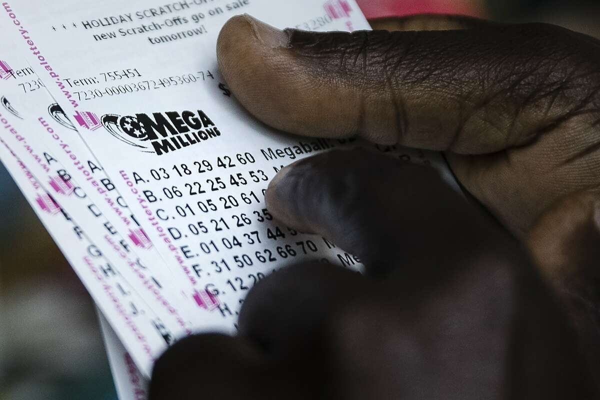A lottery player looks over his Mega Millions lottery tickets he purchased at a news stand in Philadelphia, Monday, Oct. 22, 2018. No one won the $1 billion jackpot in Saturday night's drawing, which means the top prize for Tuesday night's Mega Millions drawing would be the largest lottery jackpot in U.S. history.