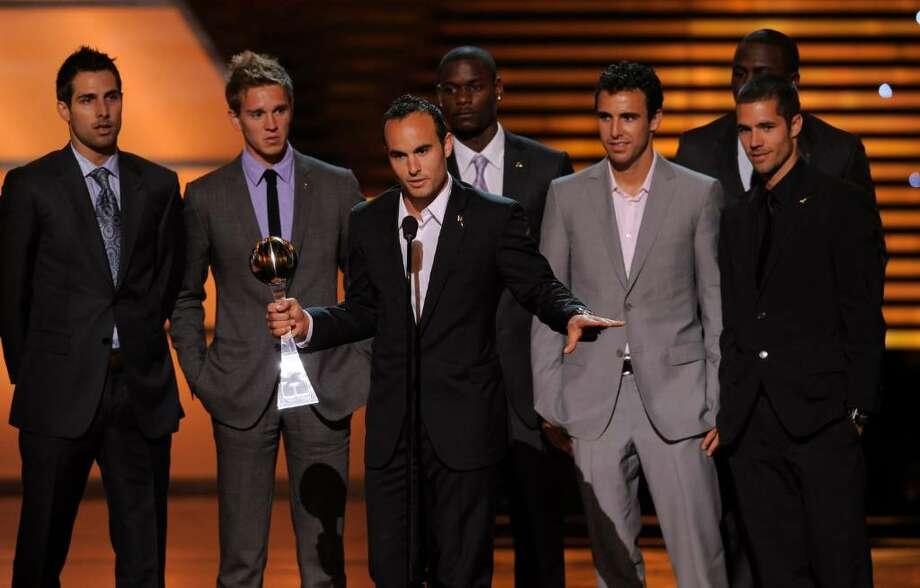 Landon Donovan with teammates accept the award for best moment at the ESPY Awards on Wednesday, July 14, 2010 in Los Angeles. Background, from left, Carlos Bocanegra, Stuart Holden, Maurice Edu, Jonathan Bornstein, Jozy Altidore and Benny Feilhaber. (AP Photos/Chris Pizzello) Photo: Chris Pizzello