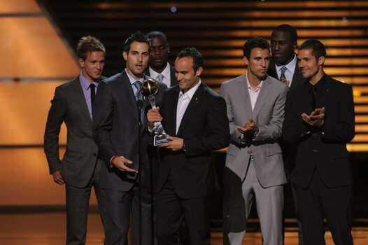 Carlos Bocanegra, center left, and Landon Donovan, center right, with teammates accept the award for best moment at the ESPY Awards on Wednesday, July 14, 2010 in Los Angeles. Background, from left, Stuart Holden, Maurice Edu, Jonathan Bornstein, Jozy Altidore and Benny Feilhaber. (AP Photos/Chris Pizzello) Photo: Chris Pizzello / AP