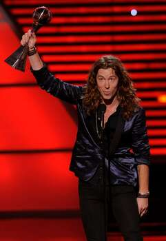 Shaun White accepts the award for best U.S. male olympian at the ESPY Awards on Wednesday, July 14, 2010 in Los Angeles. (AP Photos/Chris Pizzello) Photo: Chris Pizzello