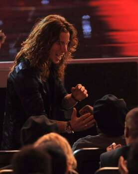 Shaun White shakes hands with Samuel L. Jackson as he gets ready to accept the award for best U.S. male olympian at the ESPY Awards on Wednesday, July 14, 2010 in Los Angeles. (AP Photos/Chris Pizzello) Photo: Chris Pizzello