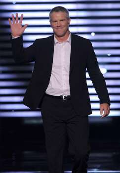 Brett Favre is seen on stage at the ESPY Awards on Wednesday, July 14, 2010 in Los Angeles. (AP Photos/Chris Pizzello) Photo: Chris Pizzello