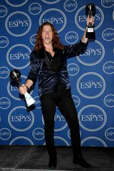 Snowboarder Shaun White poses with the awards for Best Male Action Sport Athlete and Best US Male Olympian in the press room at the ESPY Awards on Wednesday, July 14, 2010 in Los Angeles. (AP Photo/Dan Steinberg) Photo: Dan Steinberg