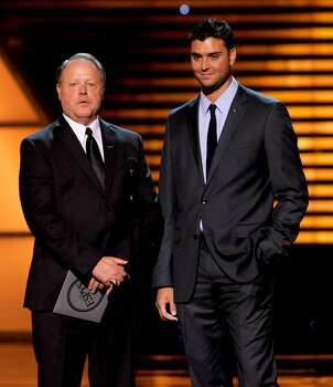 Major League Baseball Umpire Jim Joyce, left, and Detroit Tigers pitcher Armando Galarraga are seen on stage at the ESPY Awards on Wednesday, July 14, 2010 in Los Angeles. (AP Photos/Chris Pizzello) Photo: Chris Pizzello