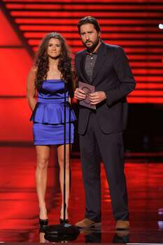 Race car driver Danica Patrick and actor Luke Wilson present the best team award at the ESPY Awards on Wednesday, July 14, 2010 in Los Angeles. (AP Photos/Chris Pizzello) Photo: Chris Pizzello