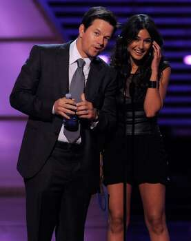 Mark Wahlberg, left, and Emmanuelle Chriqui present the award for best female athlete at the ESPY Awards on Wednesday, July 14, 2010 in Los Angeles. (AP Photos/Chris Pizzello) Photo: Chris Pizzello