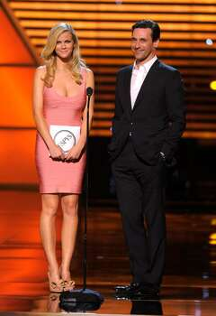 Brooklyn Decker, left, and Jon Hamm present the award for best play at the ESPY Awards on Wednesday, July 14, 2010 in Los Angeles. (AP Photos/Chris Pizzello) Photo: Chris Pizzello