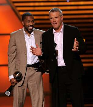 Greg Lewis, left, and Brett Favre, both of the Minnesota Vikings, accept the award for best play at the ESPY Awards on Wednesday, July 14, 2010 in Los Angeles. (AP Photos/Chris Pizzello) Photo: Chris Pizzello