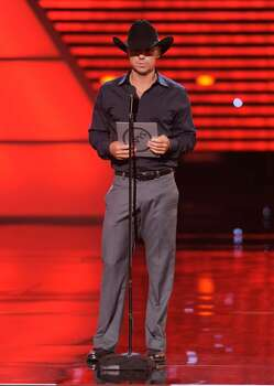 Kenny Chesney presents the award for best male athlete at the ESPY Awards on Wednesday, July 14, 2010 in Los Angeles. (AP Photos/Chris Pizzello) Photo: Chris Pizzello