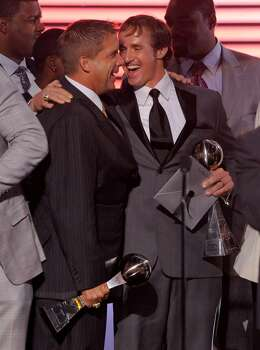 New Orleans Saints football head coach  Sean Payton, left, with the award for best team and Saints quarterback Drew Brees who won best male athlete react at the end of the at ESPY Awards on Wednesday, July 14, 2010 in Los Angeles. (AP Photos/Chris Pizzello) Photo: Chris Pizzello