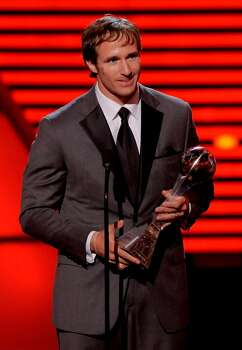 New Orleans Saints football quarterback Drew Brees accepts the award for best male athlete at the ESPY Awards on Wednesday, July 14, 2010 in Los Angeles. (AP Photos/Chris Pizzello) Photo: Chris Pizzello