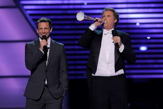 Seth Meyers, left, and Will Ferrell are seen on stage at the ESPY Awards on Wednesday, July 14, 2010 in Los Angeles. (AP Photos/Chris Pizzello) Photo: Chris Pizzello
