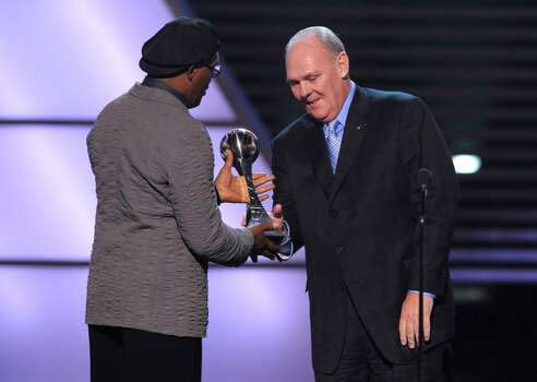 Samuel L. Jackson, left, presents Denver Nuggets basketball coach George Karl with the Jimmy V Award for perseverance at the ESPY Awards on Wednesday, July 14, 2010 in Los Angeles. (AP Photos/Chris Pizzello) Photo: Chris Pizzello