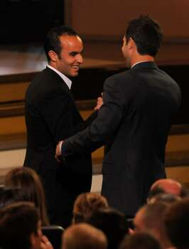 United States soccer team member Landon Donovan, left, and Carlos Bocanegra are seen before accepting the award for best moment at the ESPY Awards on Wednesday, July 14, 2010 in Los Angeles. (AP Photos/Chris Pizzello) Photo: Chris Pizzello