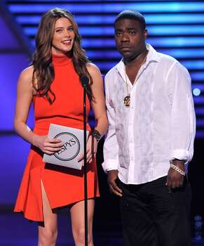 Ashley Greene, left, and Tracy Morgan present the best upset at the ESPY Awards on Wednesday, July 14, 2010 in Los Angeles. (AP Photos/Chris Pizzello) Photo: Chris Pizzello
