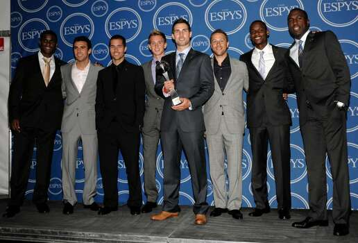Members of the United States Men's Soccer team, from left, Edson Buddle, Jonathan Bornstein, Benny Feilhaber, Stuart Holden, Carlos Bocanegra, Steve Cherundolo, Maurice Edu and Jozy Altidore pose with the award for Best Moment in the press room at the ESPY Awards on Wednesday, July 14, 2010 in Los Angeles. (AP Photo/Dan Steinberg) Photo: Dan Steinberg