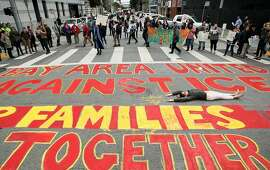 A San Francisco protest against immigration raids outside the Department of Homeland Security offices� on Feb. 28, 2018. Author and immigration attorney Hamid Yazdan Panah offers suggestions for how to stop immigration raids in the Bay Area.