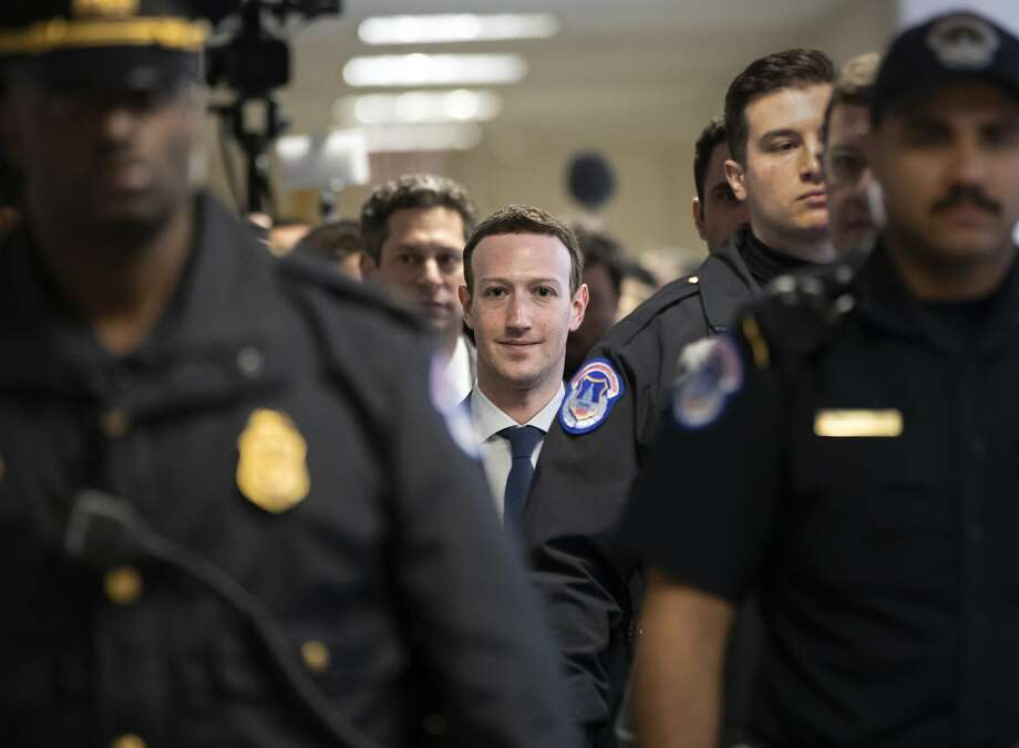 This man wants to help you find a date. In this file photo, Facebook CEO Mark Zuckerberg is arriving in Washington to testify before the Senate Judiciary Committee on the use of Facebook data. Facebook recently announced its making its dating service available in the U.S. Photo: J. Scott Applewhite / Associated Press
