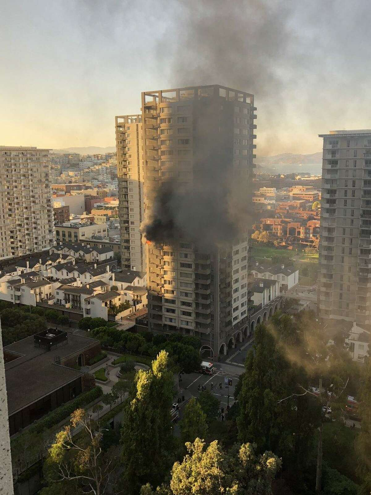 A fire is seen burning in a San Francisco residential high-rise in the Financial District at 405 Davis Street near Washington Street in a building of apartments and townhouses.