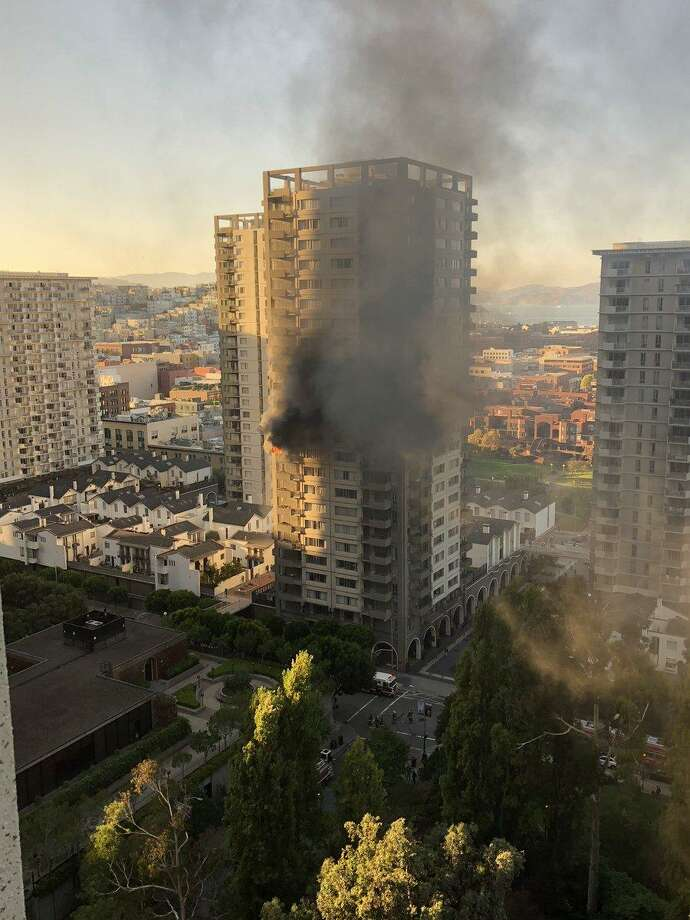 A fire is seen burning in a San Francisco residential high-rise in the Financial District at 405 Davis Street near Washington Street in a building of apartments and townhouses. Photo: Courtesy Ken Koldan
