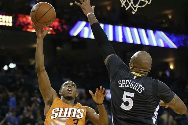 Brandon Knight, left, played parts of three seasons with the Suns before being traded to the Rockets during the offseason.