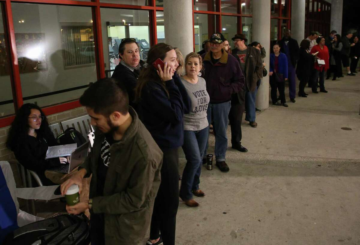 People wait in line for the early voting location at the Metropolitan Multi-Services Center on West Gray to open Monday, Oct. 22, 2018, in Houston. >>When voting, don't do this at the polls...
