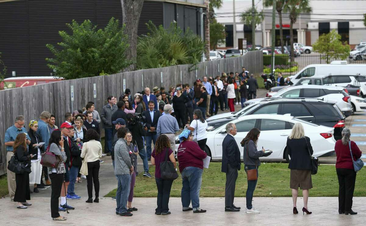 People wait in line to cast ballots at the Metropolitan Multi-Services Center on West Gray on the first day of early voting Monday, Oct. 22, 2018, in Houston.