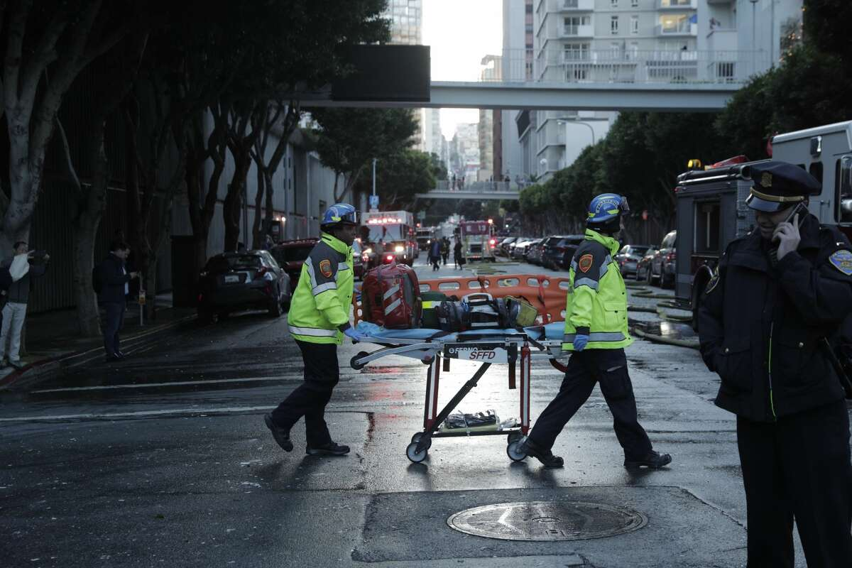 San Francisco paramedics bring a gurney to the scene of a three alarm fire in a high-rise apartment building on Davis court which was contained around 5:30 p.m. on Monday, Oct. 22, 2018.