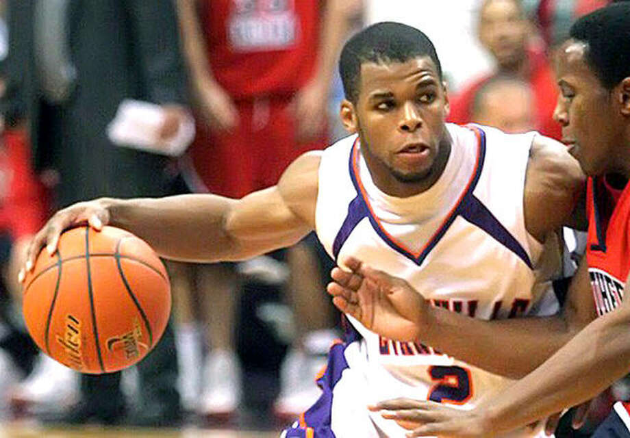 Kavon Lacey, a former Alton High and University of Evansville standout, has been hired as an assistant men's basketball coach at Lewis and Clark Community College. Lacey, who is the AHS all-time career scoring leader, is shown in action during his collegeiate days at Evansville. Photo: Purple Aces Athletics