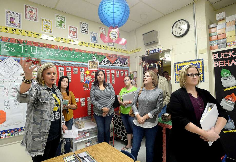 Highland Park Elementary Principal Sissy Yeaman leads a tour through the school, which is in need of repairs and upgrades during a tour of two Nederland ISD elementary schools Monday, Oct. 22. NISD Citizens Advisory Committee hosted the tours and meeting as part of their 5-month study of the facilities to investigate need for repairs. The group hopes to pass a bond to upgrade the facilities, after a similar effort failed to pass in 2009.  Photo taken Monday, October 22, 2018  Kim Brent/The Enterprise Photo: Kim Brent / The Enterprise / BEN