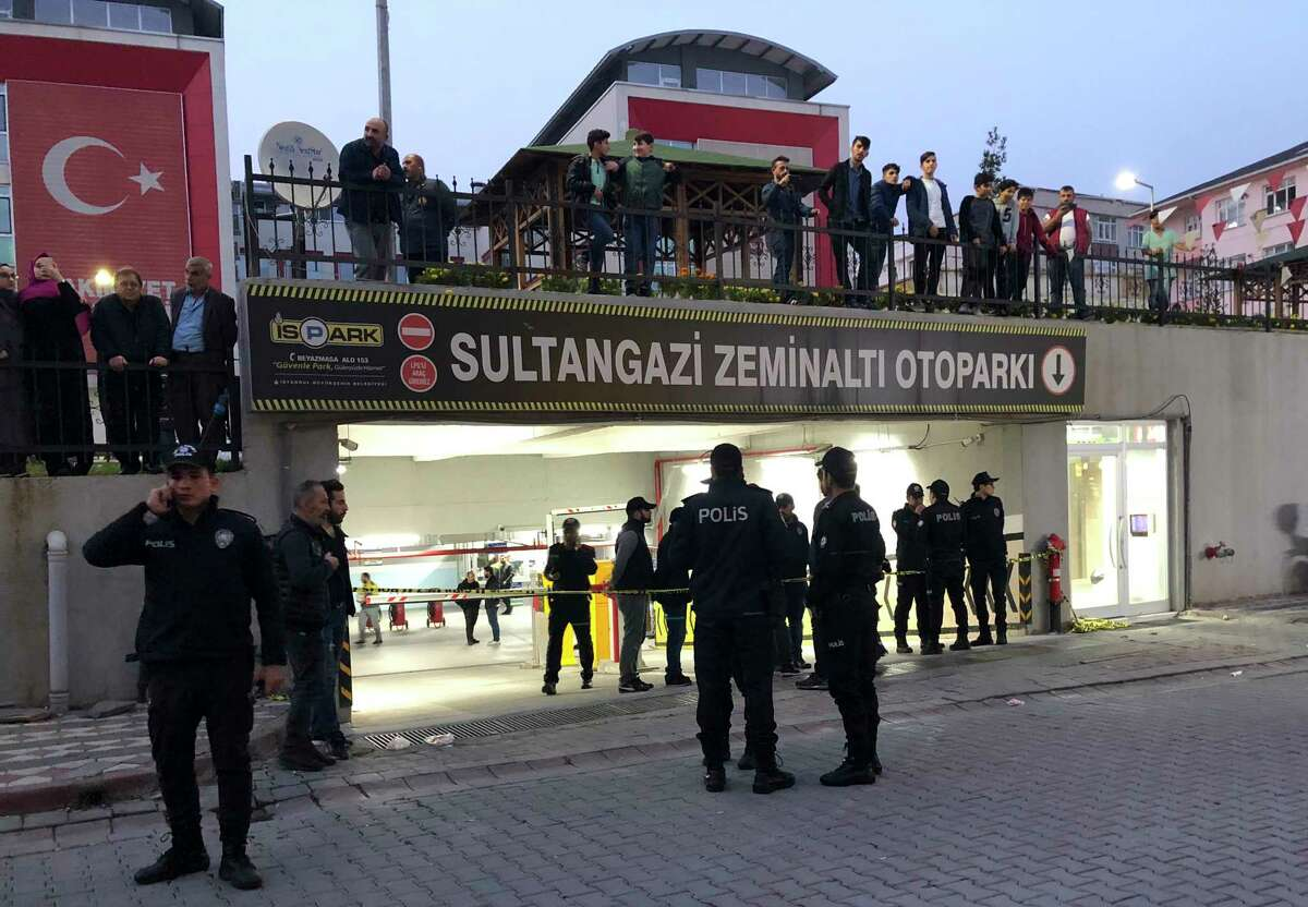Turkish police secure an underground car park, where authorities earlier found a vehicle belonging to the Saudi Consulate, in Istanbul, Monday, Oct. 22, 2018. Turkish crime-scene investigators have arrived at the park, where the car , according to news reports, was left two weeks ago. Investigators looking into the disappearance of Saudi journalist Jamal Khashoggi had last week searched other consulate vehicles, along with the consulate building and the consul general's residence.(AP Photo/Mehmet Guzel)