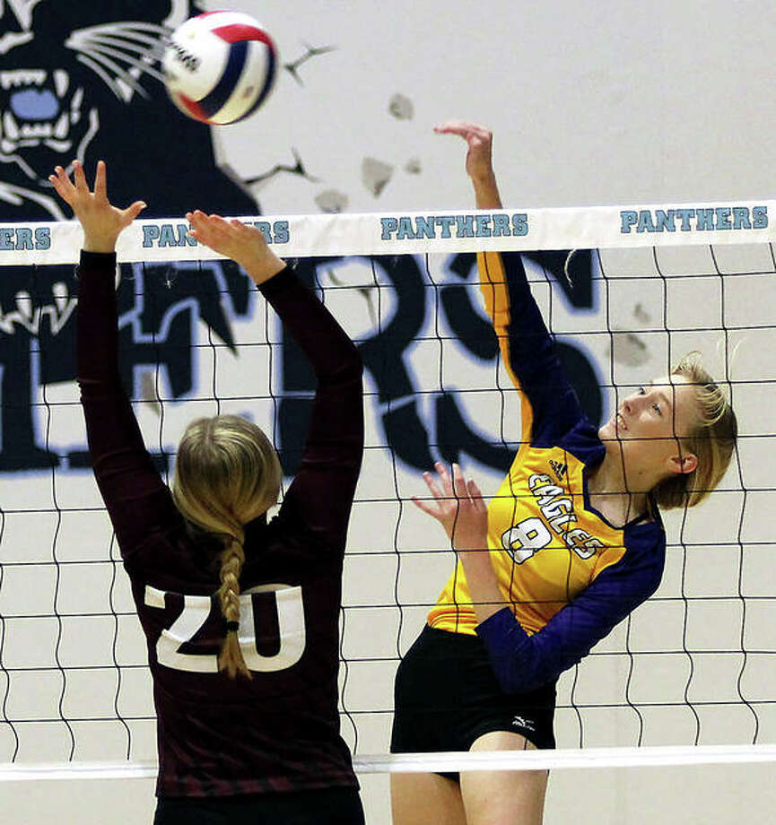 CM's Sydney Henke hits over the block of EA-WR's Taylor Parmentier during the Eagles' two-set victory in a quarterfinal match of the Jersey Class 3A Regional at Havens Gym in Jerseyville. Photo: Greg Shashack | The Telegraph
