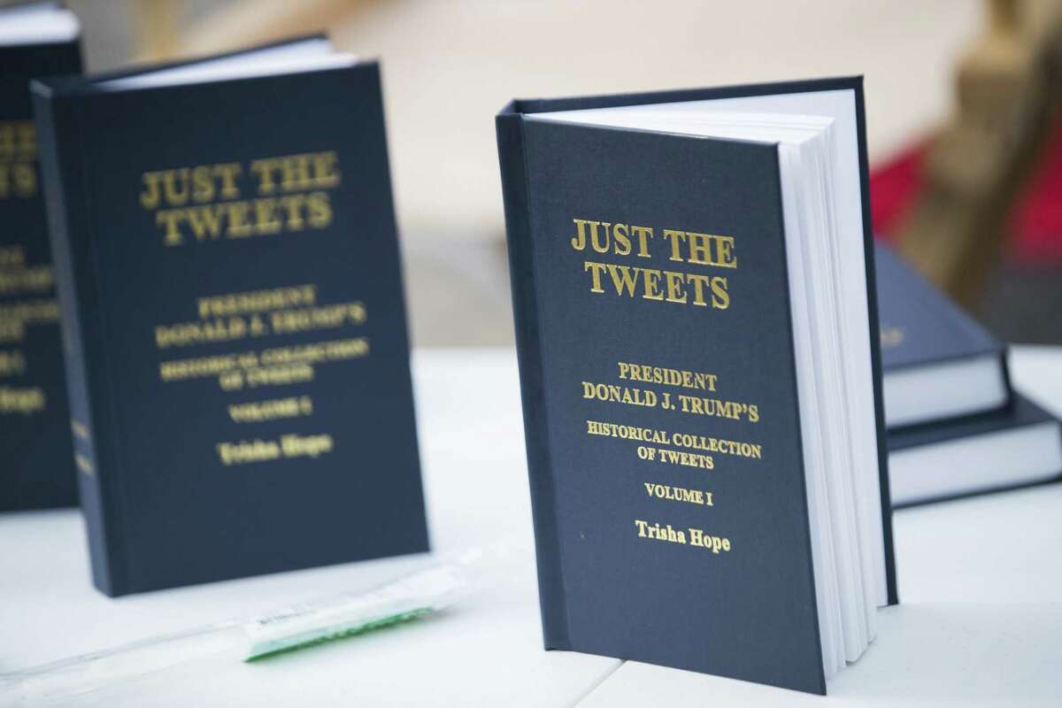 A book of President Donald Trump's tweets in front of the Toyota Center during a rally, Monday, Oct. 22, 2018, in Houston.