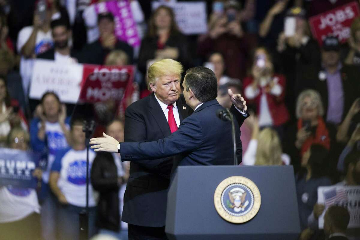 President Donald Trump embraces Senator Ted Cruz as he arrives to the podium during the MAGA Rally at the Toyota Center, Monday, Oct. 22, 2018, in Houston.