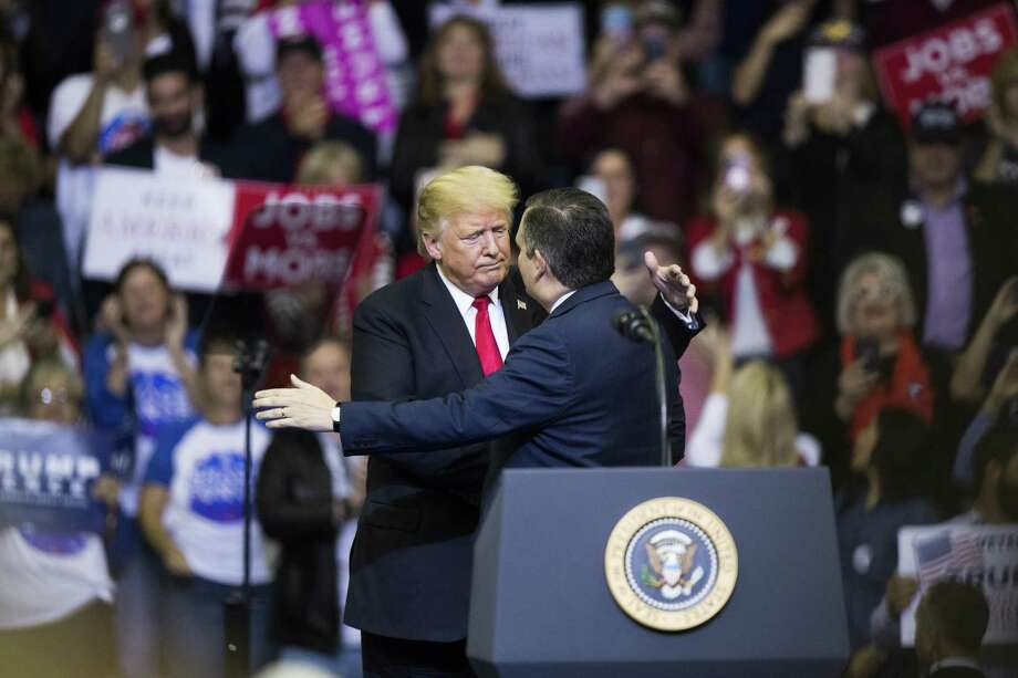 President Donald Trump embraces Senator Ted Cruz as he arrives to the podium during the MAGA Rally at the Toyota Center, Monday, Oct. 22, 2018, in Houston. Photo: Marie D. De Jesús, Houston Chronicle / Staff Photographer / © 2018 Houston Chronicle