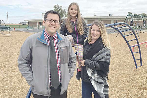 Pictured are, from left, Hamel Elementary School Principal Matt Sidarous, Olivia Scheller and Janet Scheller.