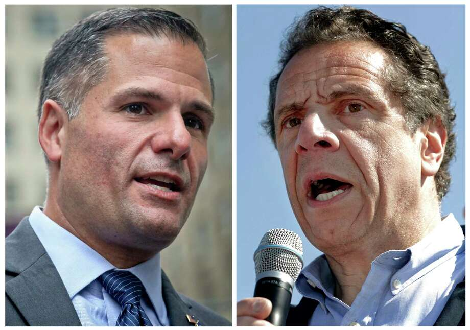 FILE - In this combination photo, New York Republican gubernatorial candidate Marc Molinaro, left, speaks at a news conference in New York on Sept. 14, 2018, and New York Gov. Andrew Cuomo, right, speaks a news conference in in Tarrytown; N.Y., on May 8, 2018. Cuomo is balking at requests to debate his opponents, potentially leaving New Yorkers without the chance to see the candidates for governor face each other before the Nov. 6 election. Molinaro had asked for a one-on-one debate with the two-term incumbent, and three third-party candidates had pushed for a more inclusive exchange. (AP Photos/Bebeto Matthews, left, and Julio Cortez, Files) / Copyright 2018 The Associated Press. All rights reserved.