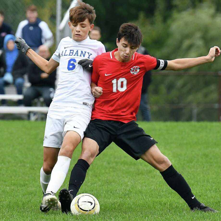 Albany High's #6 Harrison Leon, left, and Niskayuna's #10  Merjan Ozisik battle during Saturday's game Oct. 6, 2018 in Niskayuna, NY.  (John Carl D'Annibale/Times Union) Photo: John Carl D'Annibale / 20044983A