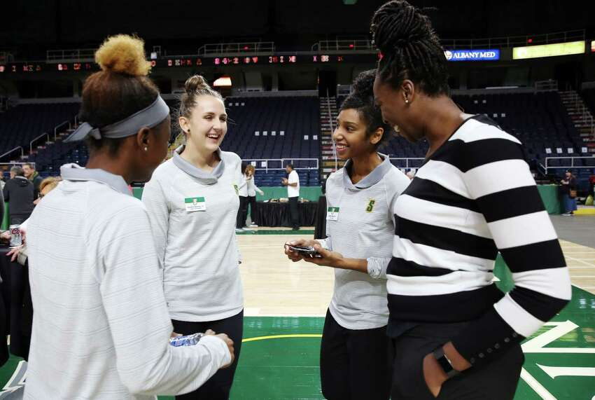 From left, Siena women's basketball players Aaliyah Jones, Karolina Severova, Sabrina Piper talk with assistant coach Jessica Simmonds during the Siena Basketball ?