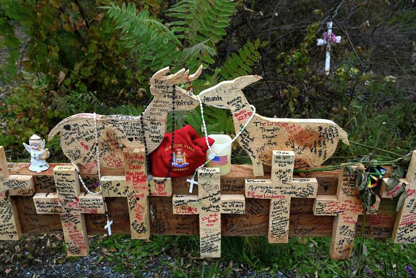 The makeshift memorial is decorated with many flowers and mums at the site of the limousine accident that took the lives of 20 people Monday Oct.22, 2018 in Schoharie, N.Y. (Skip Dickstein/Times Union)