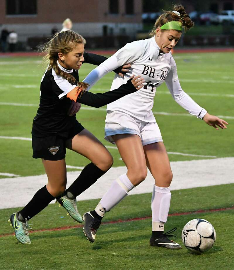 Mohonasen's Liv Raucci, left, battles for the ball with Burnt Hills-Ballston Lake's Chelsea Speranza during a Class A girls' soccer semifinal on Monday, Oct. 22, 2018 in Stillwater, N.Y. (Lori Van Buren/Times Union) Photo: Lori Van Buren / 20045197A