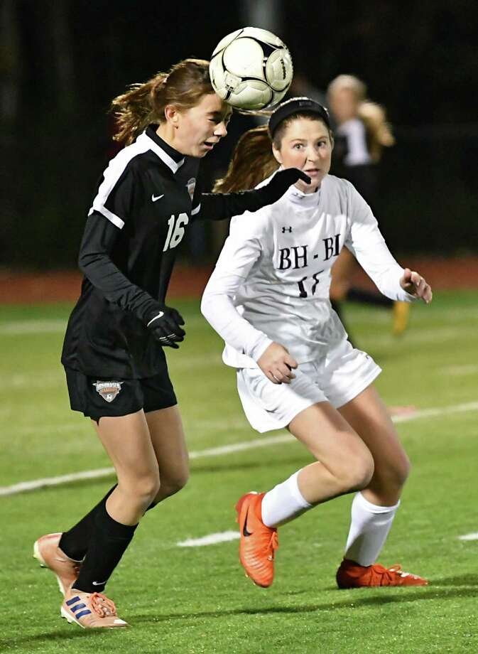 Mohonasen's Emily Gandrow, left, heads the ball guarded by Burnt Hills-Ballston Lake's Mollie Boone during a Class A girls' soccer semifinal on Monday, Oct. 22, 2018 in Stillwater, N.Y. (Lori Van Buren/Times Union) Photo: Lori Van Buren / 20045197A