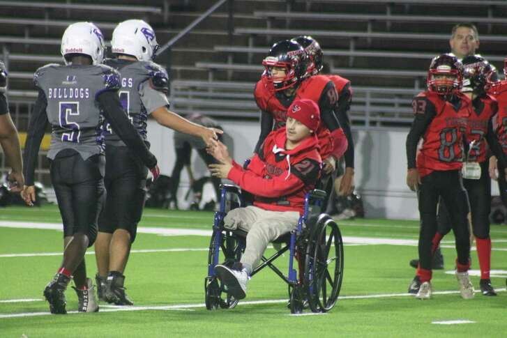 San Jacinto Tigers player Jaylon Vela participates in the postgame greetings, following his touchdown to end the contest at Veterans Memorial Stadium Monday night.