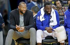 Golden State Warriors' DeMarcus Cousins and Draymond Green during 123-103 win over Phoenix Suns during NBA game at Oracle Arena in Oakland, Calif.. on Monday, October 22, 2018.
