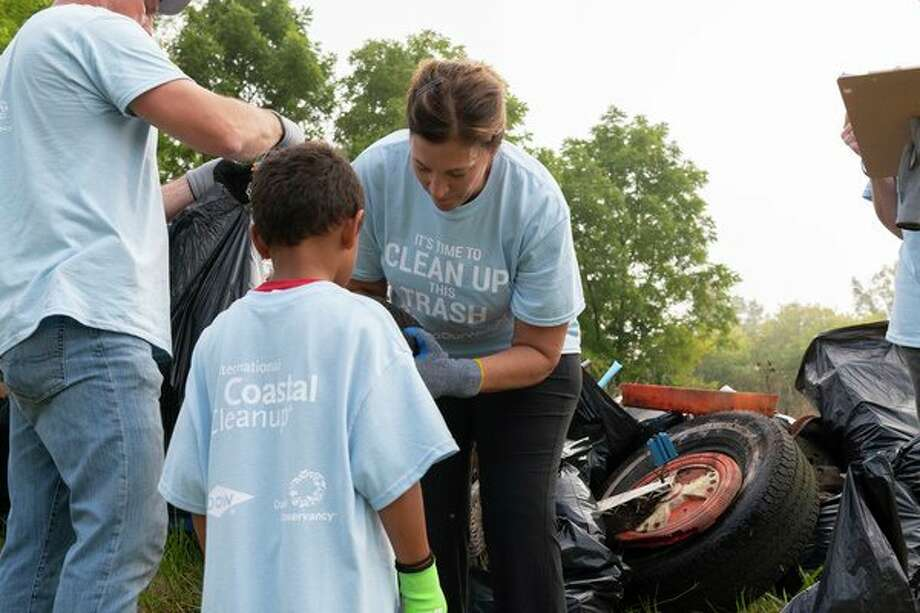 Employees, families, friends and customers of The Dow Chemical Co. are collaborating with organizations across the world and Ocean Conservancy to take part in beach and waterway cleanups at more than 50 locations.(Photo provided) / 2018 GLENN PHOTOGRAPHY