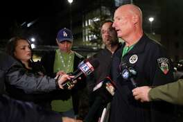 """University of Utah Police Lt. Brian Wahlin talks to members of the media outside of the South Medical Tower on the University of Utah campus during a search for a man they say shot and killed a University of Utah student outside of a dormitory on campus, the Salt Lake Tribune reported Monday, Oct. 22, 2018, in Salt Lake City. The female student's body was found in a car near the medical towers, Wahlin said. The man they are searching for and the student had """"a previous relationship,"""" Wahlin said. (Kristin Murphy//The Deseret News via AP)"""