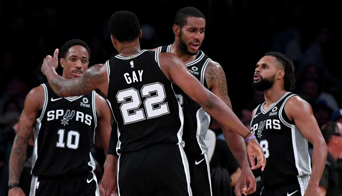 LOS ANGELES, CA - OCTOBER 22: LaMarcus Aldridge #12 of the San Antonio Spurs celebrates a 143-142 overtime win over the Los Angeles Lakers with Rudy Gay #22, DeMar DeRozan #10 and Patty Mills #8 at Staples Center on October 22, 2018 in Los Angeles, California. (Photo by Harry How/Getty Images)