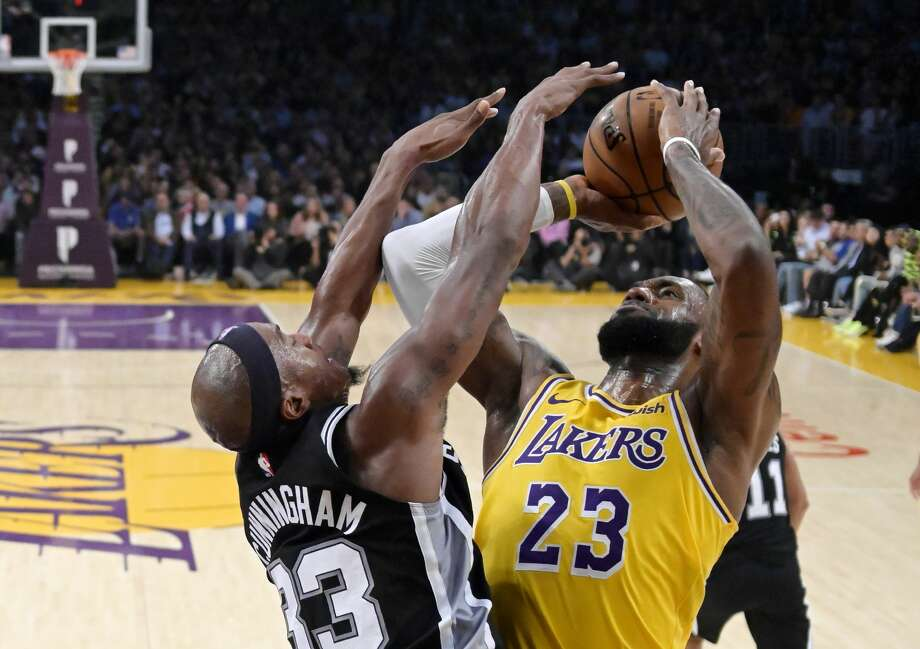 Los Angeles Lakers forward LeBron James, right, shoots as San Antonio Spurs forward Dante Cunningham defends during the second half of an NBA basketball game Monday, Oct. 22, 2018, in Los Angeles. The Spurs won 143-142. (AP Photo/Mark J. Terrill) Photo: Mark J. Terrill/AP