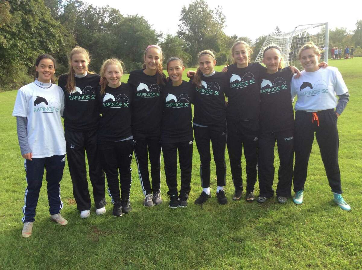 Members of the Sacred Heart Greenwich soccer team helped out at the Megan Rapinoe soccer clinic held at Sacred Heart on Saturday.