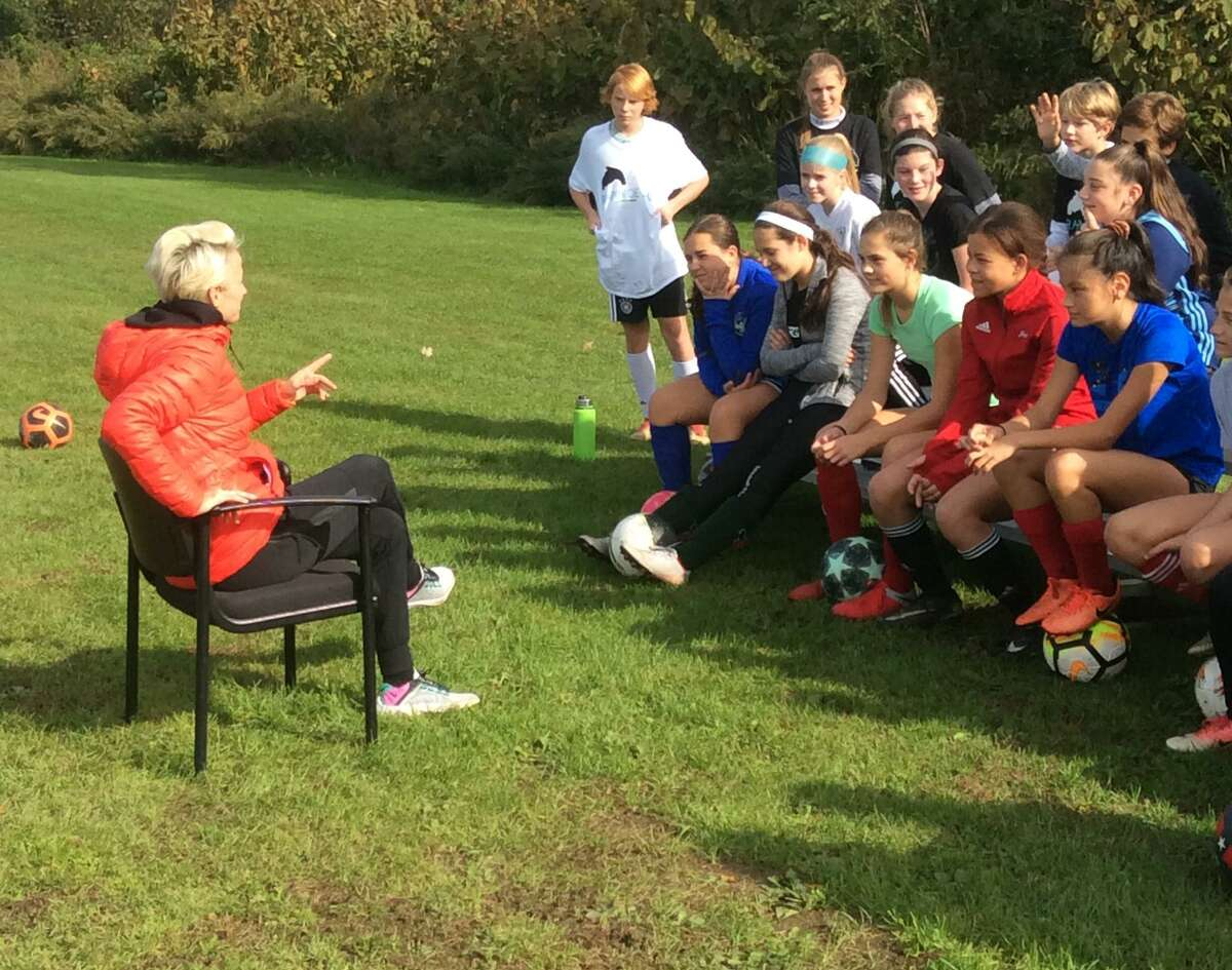 Megan Rapinoe, a member of the U.S. women's national soccer team, addresses a group of youngsters during a Q&A session at her soccer clinic, held at Sacred Heart Greenwich on Saturday.
